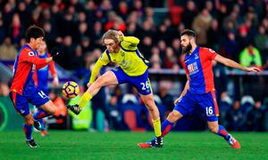 Everton's Tom Davies (centre) in action with Crystal Palace's Lee Chung-yong (left) and Joe Ledley. Photo credit: John Walton/PA Wire