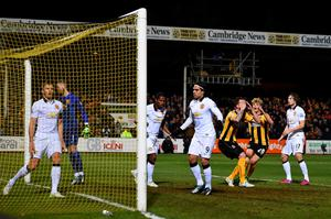 Josh Coulson of Cambridge United reacts to a missed opportunity during the FA Cup Fourth Round match between Cambridge United and Manchester United