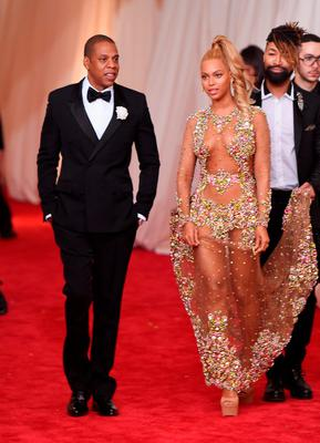"""Jay Z (L) and Beyonce attend the """"China: Through The Looking Glass"""" Costume Institute Benefit Gala at the Metropolitan Museum of Art on May 4, 2015 in New York City.  (Photo by Mike Coppola/Getty Images)"""