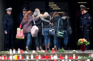 Students hold onto each other as they arrive at the Joseph-Koenig-Gymnasium high school in Haltern am See March 25, 2015. REUTERS/Ina Fassbender
