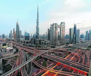 Deserted: Dubai's Sheikh Zayed Road is free of traffic as citizens are encouraged to stay home. Photo: Reuters/Satish Kumar