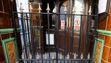 Pub doors are locked in Dublin, as bars across Ireland close voluntarily to curb the spread of coronavirus. Photo: REUTERS/Lorraine O'Sullivan/File Photo