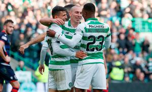 Celtic's Mohamed Elyounoussi celebrates scoring his side's sixth goal of the game with Scott Brown and Bold Bolingoli (right) during the Ladbrokes Scottish Premiership match at Celtic Park, Glasgow. Steve Welsh/PA Wire.