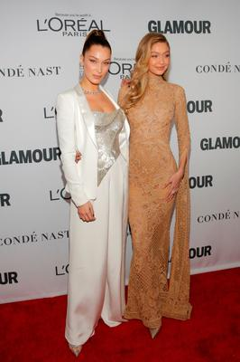 Models Bella Hadid and Gigi Hadid attend the 2017 Glamour Women of the Year Awards at the Kings Theater in Brooklyn, New York, U.S., November 13, 2017.  REUTERS/Andrew Kelly