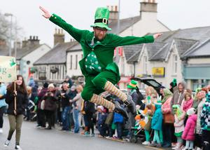 Leprechaun Killian McGreal entertains the crowd at the first ever St. Patrick's Day Parade in Blessington, Co. Wicklow (PHOTO - DAVE BARRETT)
