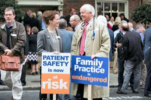 Dr Joie Fay and her father Dr Michael Fay at the GPs' protest outside Leinster House. Picture Andres Poveda