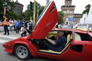 Sports car owner at starting point. (OLIVIER MORIN/AFP/Getty Images)