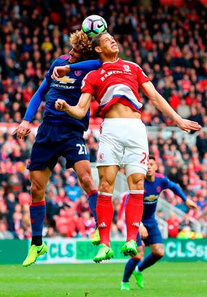 Marouane Fellaini of Manchester United (L) and Rudy Gestede of Middlesbrough (R) battle to win a header. Photo by Matthew Lewis/Getty Images