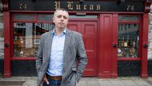 'Pointless for us to come back':  Darragh McAllister outside his closed pub Lucas Bar on Parnell Street in Ennis, Co Clare. Photo: Eamon Ward