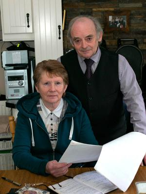 Catherine Corless and her husband Aidan reading a copy of the report from the commission of investigation yesterday morning at their home in Brownsgrove just outside Tuam. Photo: Andy Newman