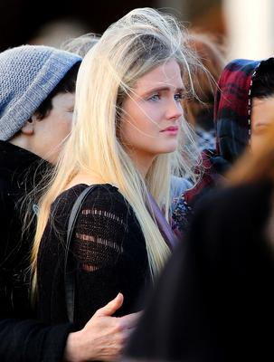 A mourner outside the church as Ashling's remains are placed into the hearse after the funeral mass.  Picture: Gerry Mooney