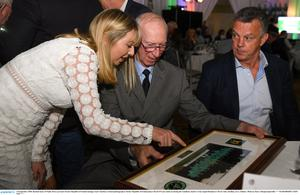 Rachael Kane of Paddy Power presents Former Republic of Ireland manager Jack Charlton a framed photograph as former Republic of Ireland player David O'Leary looks on during the Goodbody Jackie's Army Squad Reunion at The K Club, Straffan in 2018