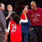 Kobe Bryant (24) high-fives his daughter Gianna on the court in warm-ups before first half NBA All-Star Game basketball action in Toronto back in February 2016. Bryant, his 13-year-old daughter, Gianna, and several others are dead after their helicopter went down in Southern California on Sunday. (Mark Blinch/The Canadian Press via AP)