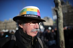PARIS, FRANCE - JANUARY 11:  Demonstrators gather in Place de la Republique prior to a mass unity rally to be held in Paris following the recent terrorist attacks on January 11, 2015 in Paris, France. An estimated one million people are expected to converge in central Paris for the Unity March joining in solidarity with the 17 victims of this week's terrorist attacks in the country. French President Francois Hollande will lead the march and will be joined by world leaders in a sign of unity. The terrorist atrocities started on Wednesday with the attack on the French satirical magazine Charlie Hebdo, killing 12, and ended on Friday with sieges at a printing company in Dammartin en Goele and a Kosher supermarket in Paris with four hostages and three suspects being killed. A fourth suspect, Hayat Boumeddiene, 26, escaped and is wanted in connection with the murder of a policewoman.  (Photo by Christopher Furlong/Getty Images)