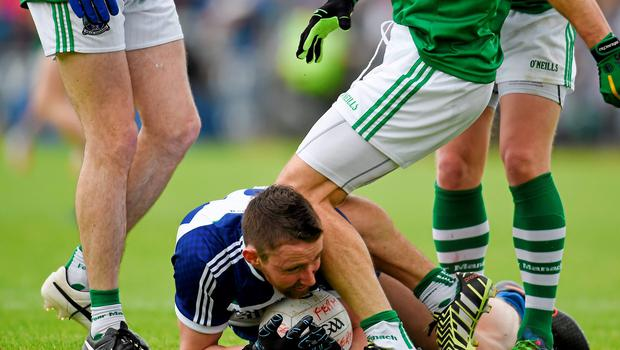 21 June 2015; Ryan McCluskey, Fermanagh, gets involved in an incident on the ground with Owen Duffy, Monaghan. Ulster GAA Football Senior Championship Semi-Final, Monaghan v Fermanagh, Kingspan Breffni Park, Cavan. Picture credit: Paul Mohan / SPORTSFILE
