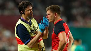 England's Owen Farrell receives attention from doctor. Photo: David Rogers/Getty Images
