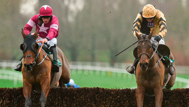 Invitation Only, with Ruby Walsh up, jumps the last alongside runner-up Alpha Des Obeaux (Rob James) on the way to winning the Thyestes Chase. Photo: Matt Browne/Sportsfile