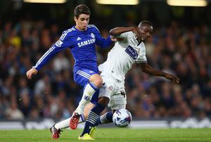 Chelsea's Oscar is blocked off by Medo Kamara of Bolton during their Captial One Cup game at Stamford Bridge. Photo: Ian Walton/Getty Images