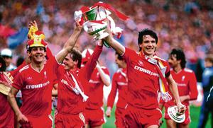 Realising his dreams: Jim Beglin (left) and Alan Hansen parade the FA Cup at Wembley after their 1986 final triumph against Everton that completed the double. Photo: Liverpool FC via Getty Images