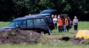 Families of two of the IRA Disappeared look on as two sets of human remains are removed from a reclaimed bog in Coghalstown, Co Meath. PRESS ASSOCIATION Photo. Picture date: Friday June 26, 2015. The bodies - which will undergo DNA tests over the next few weeks - are thought to be that of Seamus Wright and Kevin McKee, both abducted and murdered by the terror group in Belfast in October 1972. See PA story IRISH Lynskey. Photo credit should read: Niall Carson/PA Wire