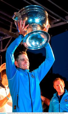 21 September 2015; Dublin's Stephen Cluxton lifts the Sam Maguire cup on stage during the team homecoming. O'Connell St, Dublin. Picture credit: Paul Mohan / SPORTSFILE