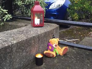 Tributes left at the scene of a toddler's death (Photo: Conor Feehan)