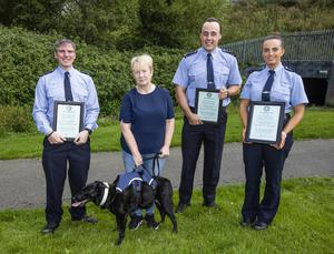 Garda Brendan Crawford, Garda Ciaran Murray and Garda Ciara Galvin from Clondalkin Garda station who recieved award's of commendation with distinction for excellent police work after rescuing Ann Lam and her dog Millie from the river Camac in Dublin.  Pic:Mark Condren, 26.6.2020