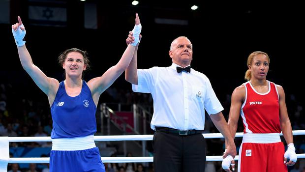 27 June 2015; Katie Taylor, Ireland, is declared victorious over Estelle Mossely, France, by referee Mariusz Gorny, following their Women's Boxing Light 60kg Final bout. 2015 European Games, Crystal Hall, Baku, Azerbaijan. Picture credit: Stephen McCarthy / SPORTSFILE