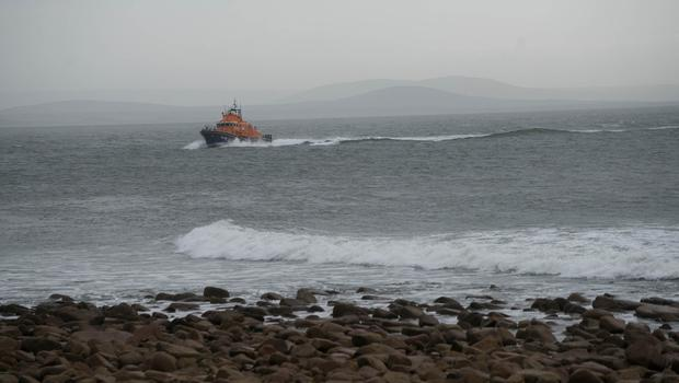 The lifeboat searching for a Coast Guard Helicopter Missing at Blacksod lighthouse, Belmullet, Co. Mayo. Photo : Keith Heneghan / Phocus