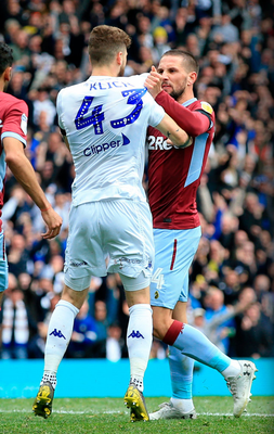 UNBELIEVABLE SCENES: Leeds United's Mateusz Klich is confronted by Aston Villa's Conor Hourihane after he had scored a controversial goal. Photo: Clint Hughes/PA Wire