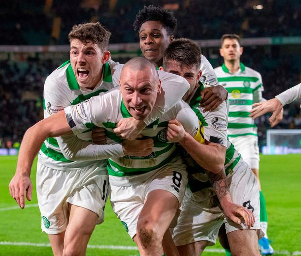 Celtic's Scott Brown celebrates with team mates. Photo: Kenny Smith/PA Wire
