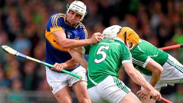 Tipp's Patrick Maher bounces off a challenge from Seanie O'Brien, 5, and Richie McCarthy