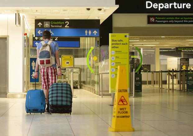 A traveller heads for departures at Dublin Airport. Photo: Gerry Mooney