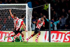 Luciano Narsingh of PSV Eindhoven celebrates scoring the winning goal against Manchester United at PSV Stadion