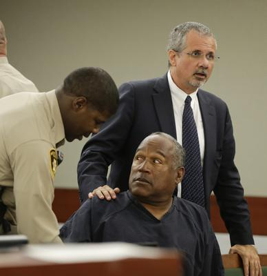 O.J. Simpson prepares to leave the courtroom
