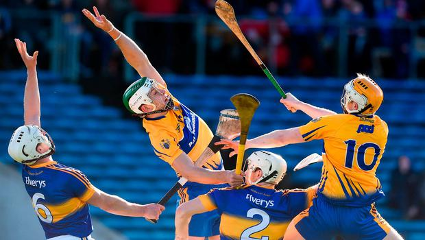 Clare's Aaron Shanagher, left, and Aaron Cunningham in action against Ronan Maher and Joe Dwyer of Tipperary. Photo: Matt Browne/Sportsfile