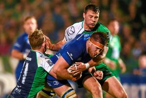Dominic Ryan, Leinster, is tackled by Matt Healy and Robbie Henshaw, Connacht