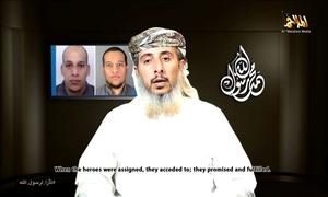 Nasser bin Ali al-Ansi, a leader of the Yemeni branch of al Qaeda, is seen in this still image taken from a social media website, which purports to show Al Qaeda in Yemen claiming responsibility for the attack on the French satirical newspaper, saying it was ordered by the Islamist militant group's leadership for insulting the Prophet Mohammad (REUTERS/YouTube via Reuters)