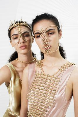 Cadhla, left, wears: Gold spike headpiece, €300; gold spike spine piece, €1,500; Sadhbh, right, wears: Gold beaded headpiece, €250; gold beaded couture waistcoat, €2,750, all Bláithín Ennis. Photo: Andrew Nuding
