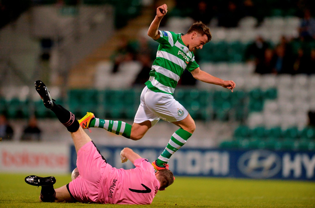 Dean Clarke of Shamrock Rovers in action against Graham Doyle of Wexford Youths. Photo: Eóin Noonan/Sportsfile