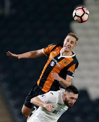 Hull City's Michael Dawson out-jumps Swansea City's Borja Baston to the ball. Photo: Reuters