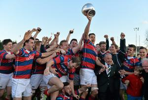 Clontarf celebrate with the Ulster Bank League trophy in April. Photo: Brendan Moran / SPORTSFILE
