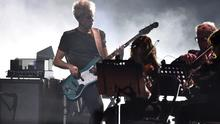 U2's bassist Adam Clayton performs on stage during the 2014 MTV Europe Music Awards at the SSE Hydro Arena in Glasgow, Scotland (REUTERS/Toby Melville)