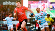 Ulster's Jacob Stockdale leaves Simon Zebo trailing on his way to scoring his side's second try at the Kingspan Stadium on Saturday. Photo by David Fitzgerald/Sportsfile