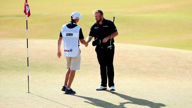 UNIVERSITY PLACE, WA - JUNE 20: Shane Lowry of Ireland and caddie Dermot Byrne shake hands on the 18th hole during the third round of the 115th U.S. Open Championship at Chambers Bay on June 20, 2015 in University Place, Washington.  (Photo by Andrew Redington/Getty Images)