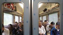Commuters are pictured on a Japan Railway train in Sapporo, Japan September 23, 2019. REUTERS/Edgar Su