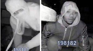 Undated handout CCTV stills issued by the Metropolitan Police of two men taking presents from under a Christmas tree which have been released by detectives