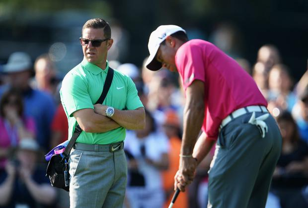 Tiger Woods has parted ways with his swing coach Sean Foley (left). Photo: Stuart Franklin/Getty Images