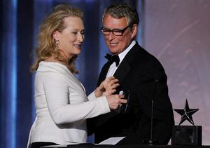 Meryl Streep and Mike Nichols as he collected his AFI Life Achievement Award in California. Nichols was a prolific director in film and theatre whose Oscar-winning movie The Graduate was a cinematic landmark of the 1960s. He died on 20 November 2014.