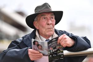 A punter looks on ahead of the Ballymore Novices' Hurdle at Cheltenham Racecourse. Photo: PA